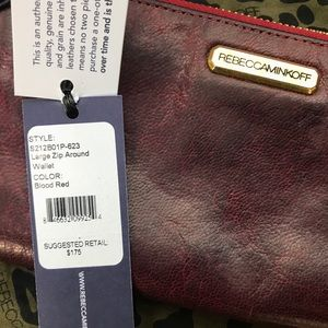 Rebecca Minkoff large zip around wallet.